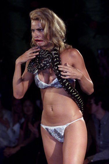 Kristy Hinze models a live python and a $1 million diamond-encrusted bikini at Jodhi Meares' Tigerlily runway show.