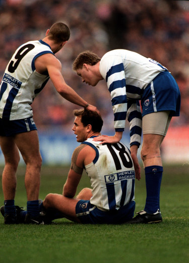Wayne Carey with teammates Brett Chandler (left) and Mark Roberts in 1998.