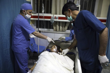 An Afghan school student is treated at a hospital after a bomb explosion near a school west of Kabul.