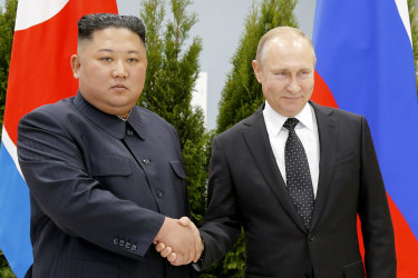 Russian President Vladimir Putin, right, and North Korea's leader Kim Jong Un shake hands during their meeting in Vladivostok.