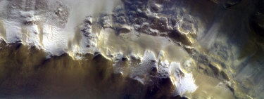 The European Space Agency has released its first image taken by a probe orbiting Mars, showing the ice-covered edge of the vast Korolev Crater.