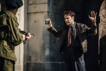 Taylor Kitsch plays a Brooklyn cop in postwar Berlin.