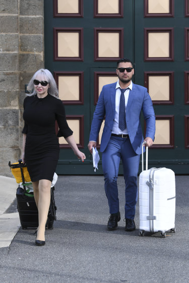 Zali Burrows and Salim Mehajer make their way to the waiting 60 Minutes crew outside Cooma prison on Tuesday.