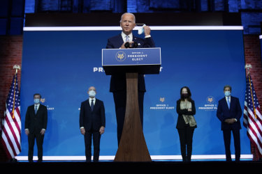 Joe Biden removes his mask to introduce his national security and foreign policy team.