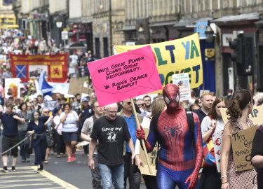 Protests followed the US president to Scotland.