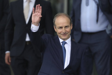 Fianna Fail party leader Micheal Martin leaves the Dail government in Dublin, where he has been officially elected as the new Irish prime minister.