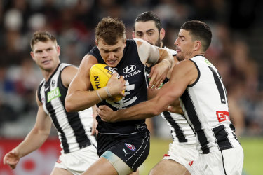 Cripps is tackled against Collingwood.