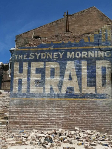 A hand-painted sign for The Sydney Morning Herald was uncovered by a demolition crew in Campsie.