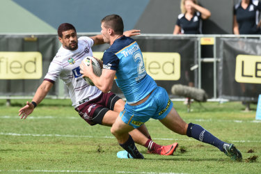 Anthony Don tries to find a way  through against Manly\'s Matthew Wright.