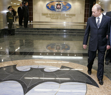 Russian President Vladimir Putin, right, walks through a hall in the building of the Main Directorate of the General Staff of the Armed Forces of Russia, also know as Russian military intelligence service in Moscow, in 2006.