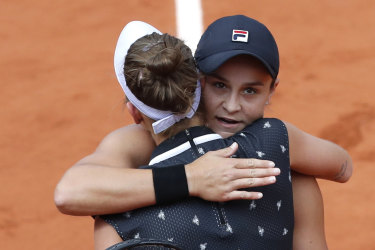 Australia's Ashleigh Barty hugs Marketa Vondrousova.
