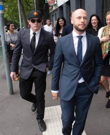 Jamie Williams (right) leaves court accompanied by Brisbane man Ashley Dyball who had fought against Islamic State.