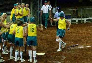The Australian softball team waiting to congratulate Peta Edebone after she hit a home run to win against China 1-0.