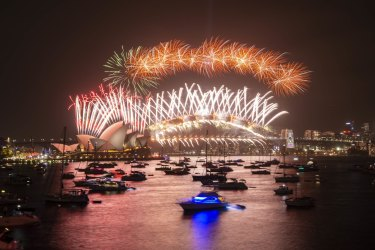 The midnight New Year's Eve fireworks on Sydney Harbour, viewed from Mrs Macquarie's Chair.