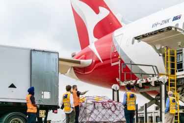 Some 450,000 Pfizer doses from the UK being loaded onto a Qantas cargo flight at Heathrow Airport bound for Sydney.