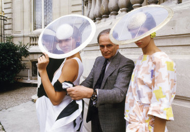 In this 1984 file photo, Cardin and models wearing ensembles from the summer 1985 ready-to-wear Cardin collection pose in Paris.