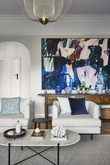 """""""The colour palette for this room was built around the beautiful art  by Antonia Mrljak – I love all her work,"""" says Amanda."""
