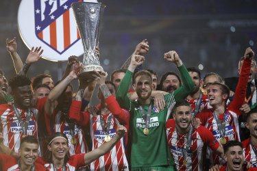 Team spirit: Atletico Madrid celebrate their Europa League final victory.