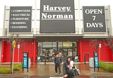 Harvey Norman has bowed to pressure and paid back JobKeeper funds.