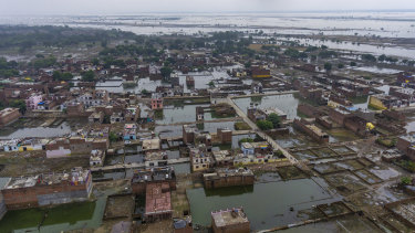 Houses are inundated with floodwaters in Prayagraj.
