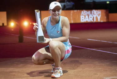 Job done: Ashleigh Barty with the Porsche Grand Prix trophy.