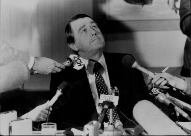 Firmly back in the chair... Premier Neville Wran at a press conference to announce the findings of the Royal Commission on July 28, 1983.