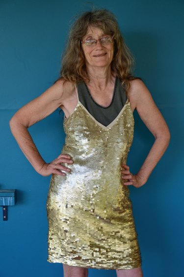 Jane Watson from Elands near Forster, is still not sure why she packed this gold sequined dress while fleeing the fires.