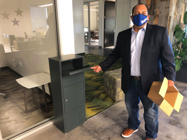 California Republican Party spokesman Hector Barajas demonstrates how to use one of the party's unofficial ballot drop boxes.