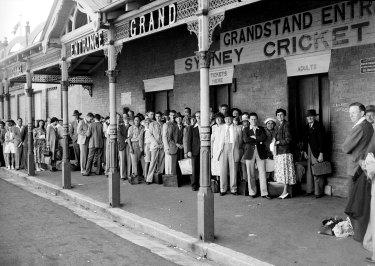 People queue for tickets at the grandstand entrance of the Sydney Cricket Ground during the 3rd Test between Australia and England on January 5, 1951.