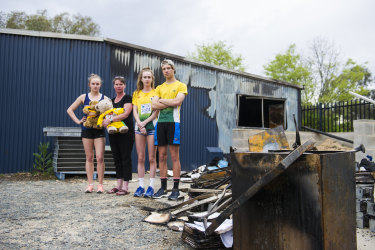 Woden Little Athletics Club secretary Mel Hardy, second from left, says it will go ahead with a meet on the weekend after Monday's devastating fire.