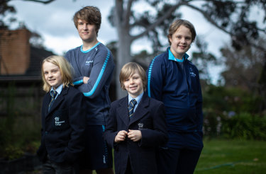 Brothers Henry, Will, Ollie and Charlie model Kingswood College's current and future school uniforms.