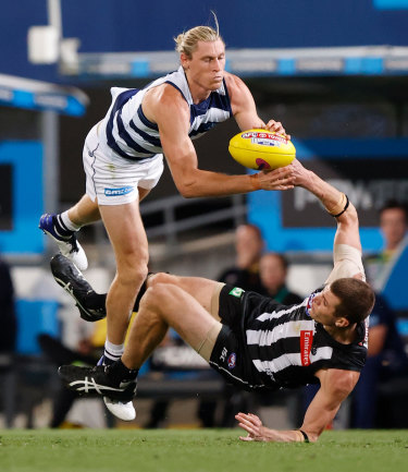 Stand over tactics: Geelong's Mark Blicavs and Collingwood's Mason Cox.