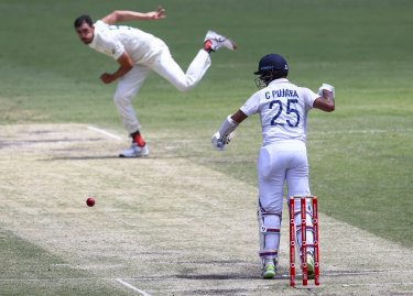 India's Cheteshwar Pujara plays at a ball from Australia's Mitchell Starc during play on the final day of the fourth cricket Test between at the Gabba.