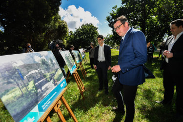 Victorian Premier Daniel Andrews reviews plans of the proposed Surrey Hills-Mont Albert premium railway station. The federal government had promised 500 car spaces towards the Surrey Hills station in 2019.