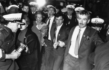 Police and security guards escort Margaret Thatcher through the  Bourke Street Mall on August 3, 1988.