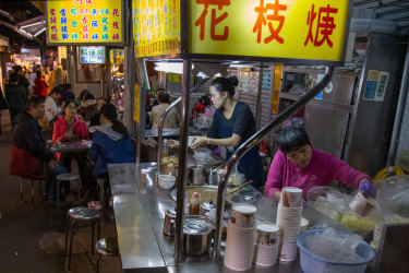 Diners eat at a food stall in Taiwan.
