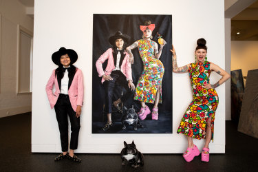 DJ  Charlie Villas and her wife Nikita Majajas with dog Ms Peaches in front of the painting of them by artist Tania Wursig which has been voted people's choice in the Salon des Refuses at SH Ervin gallery in an online people's poll.