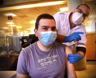 Ittay Flescher, 40, from Melbourne receiving the Pfizer vaccine in Israel.