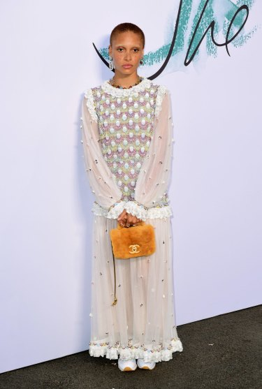 Adwoa Aboah pairs her boho dress with runners for a twist on the trend.