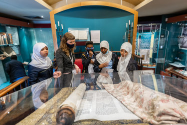 Jewish Museum education programs officer Alice Freeman with students from East Preston Islamic College.