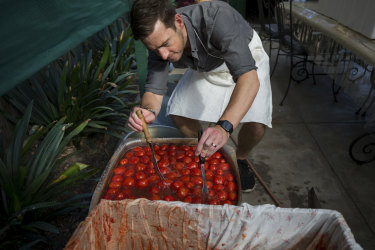 Nathan Jones helps prepare the passata tomatoes.