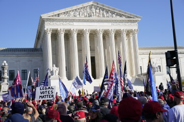 """Demonstrators gather outside of the U.S. Supreme Court building during the """"Million MAGA March"""" in Washington"""