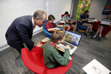 Education Minister James Merlino with students in Melbourne in April.