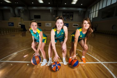Issie Bourne, centre, will play for Canberra before moving to the United States.