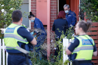 Police at Sarah Gatt's home after her body was discovered in January 2018.