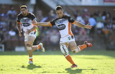 Taking charge: Tigers halfback Luke Brooks turned in a season best performance against Manly on Sunday.