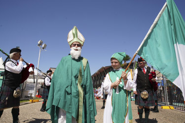 A sunglasses-clad St Patrick attends a day of festivities in his honour at Moore Park.