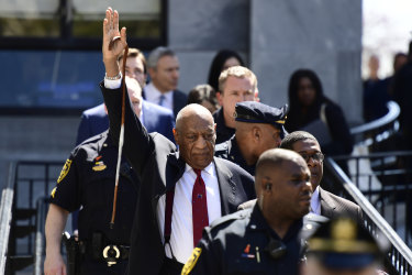 Bill Cosby gestures as he leaves his sexual assault trial at the Montgomery County Courthouse in Norristown after being convicted.