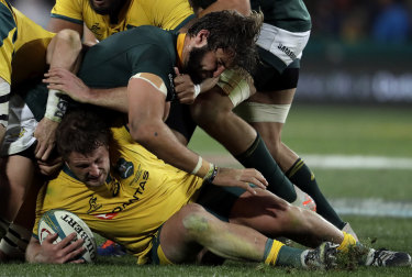 James Slipper, bottom, is tackled by South Africa's Lood de Jager,