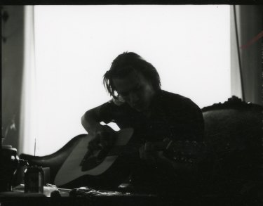Heath playing guitar, c2002,